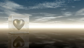Heart symbol in glass cube under cloudy sky Royalty Free Stock Photo