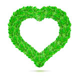 Heart symbol in green leaves. Vector illustration. Stock Images