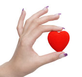 Heart symbol in hand. Heart in hand isolated over white background Royalty Free Stock Photos
