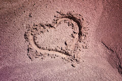 Heart symbol handwritten on soil Royalty Free Stock Image