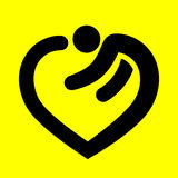 Heart symbol in human form. Heart symbol in the shape of a man on a yellow background Stock Image