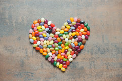 Heart symbol from jelly beans on dark background Stock Image