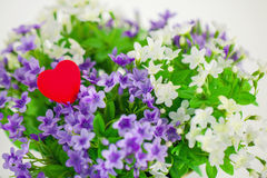Heart, symbol of love in a bouquet small flowers. Heart, a symbol of love in a bouquet of small flowers. Spring royalty free stock photos