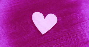 Heart - symbol of love and romance. On a bright purple background Royalty Free Stock Images