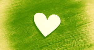 Heart - symbol of love and romance. On a green background Stock Photo