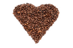 The heart symbol made from coffee beans. Isolated on white Royalty Free Stock Images