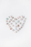 Heart symbol made of colorful buttons. On white background royalty free stock photo
