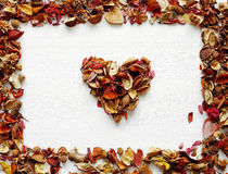 Heart symbol made of dried fragrant flowers and leaves Stock Images