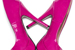 Heart symbol made from high heels shoes. A pair of pink high heels shaping a heart symbol Stock Images