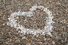 Heart symbol made of pebbles Royalty Free Stock Photos