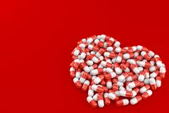 Heart symbol made from pills. On red background Royalty Free Stock Photo