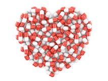 Heart symbol made from pills. Isolated on white background Stock Photos