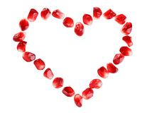 Heart symbol made from pomegranate seeds Stock Photography