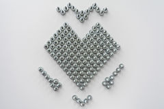 Heart symbol. Made of steel screws Royalty Free Stock Images