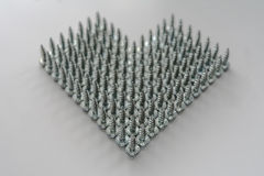 Heart symbol. Made of steel screws Royalty Free Stock Image