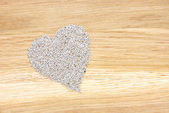 Heart symbol made of white chia seeds Stock Image