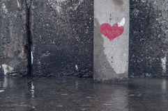 Heart symbol painted on a grunge wall Stock Image