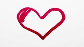 Heart symbol painted by red paint on white stock footage
