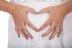 Heart symbol in pregnant belly Stock Photo