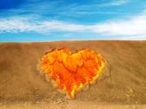 Heart symbol in sand Stock Image