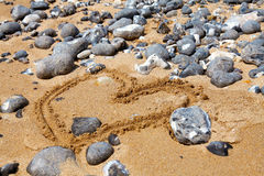 Heart symbol on the sand beach on a sunny day Royalty Free Stock Image
