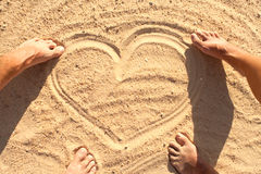 Heart symbol in sand Stock Photo
