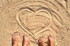 Heart symbol in sand Royalty Free Stock Photo