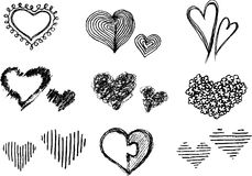 Heart Symbol Sketches. Varied hand drawn doodles of heart isolated background Royalty Free Stock Photography