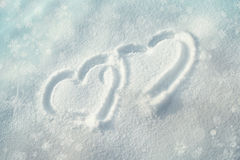 Heart symbol in the snow Stock Images