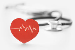 Heart symbol and stethoscope Stock Images