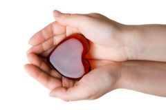 Heart symbol in woman's hands. Isolated at the white background Royalty Free Stock Images