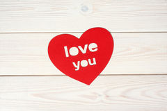 Heart symbol on a wood background. With inscription love you Stock Photography
