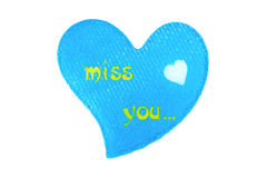 Heart with symbols. Blue heart made of cloth with symbols I miss you Stock Image