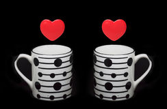 Heart symbols and cups Stock Photo