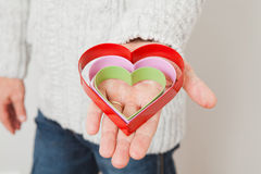 Heart symbols held in hand Stock Photos