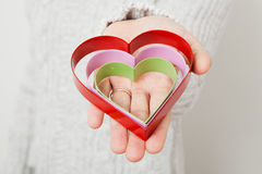 Heart symbols held in hand Royalty Free Stock Image