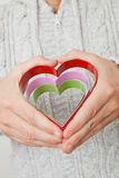 Heart symbols held in hands Royalty Free Stock Images
