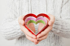 Heart symbols held in hands Stock Images