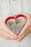 Heart symbols held in hands Royalty Free Stock Image