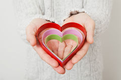 Heart symbols held in hands Stock Image