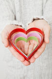 Heart symbols held in hands Royalty Free Stock Photo