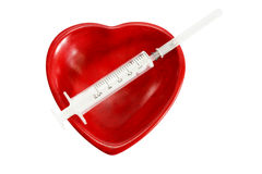 Heart and Syringe Royalty Free Stock Photo