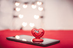 Heart on the tablet PC. Happy red love heart with heart bokeh on the tablet PC Valentines Day background royalty free illustration
