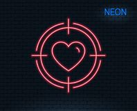 Heart in Target aim icon. Love symbol. Neon light. Heart in Target aim line icon. Love dating symbol. Valentines day sign. Glowing graphic design. Brick wall Stock Images