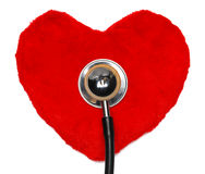 Heart tests. Red heart with a stethoscope isolated on white background royalty free stock photo