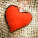Heart on a textile background. A red Heart on a textile background Royalty Free Stock Photo