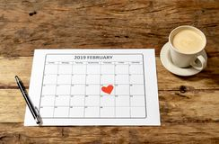 Heart on the 14th of february 2019 Calendar and coffee in planning Saint Valentines day stock images