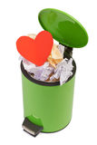 Heart thrown in the trash. The concept of separation, terminatio. N of a romantic relationship. The loss of love. Isolated on white Royalty Free Stock Photo
