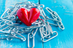 Heart tied with chains Stock Photo