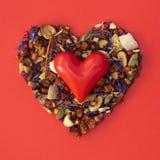 Heart to heart. Heart shape of loose tea - Valentine's Day. Heart to heart Stock Photo